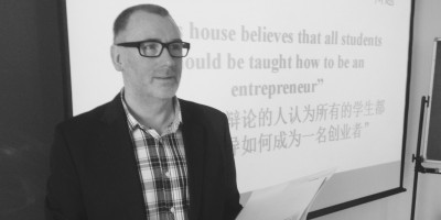 Professor Paul Coyle runs an exercise at a workshop on enterprise teaching techniques in Beijing, China.