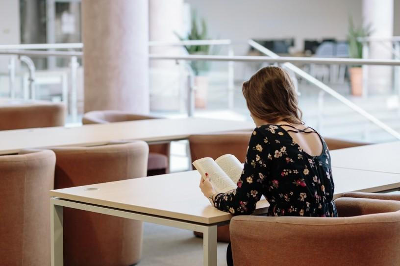 millennial woman reading a book